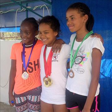 Star swimmers of the Aga Khan Academy Nairobi sprint forward at the International Championships, Dubai